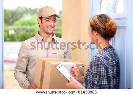 Courier delivering a parcel - stock photo