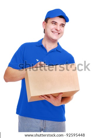 Courier in blue uniform holding the box on white background looking to the copy space area