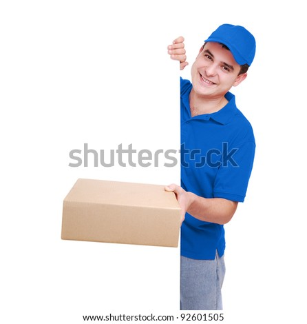 Courier in blue uniform holding the parcel and the  blank board in front of him - stock photo