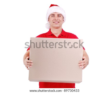 Courier in Santa hat holding a big box - stock photo