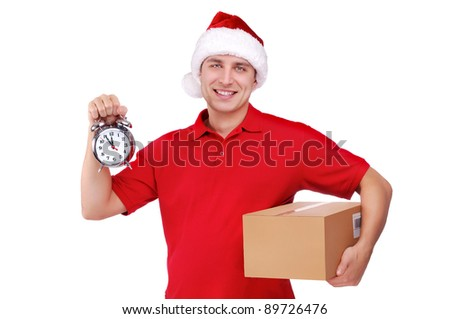 Courier in Santa hat holding a box and alarm clock: urgent delivery - stock photo