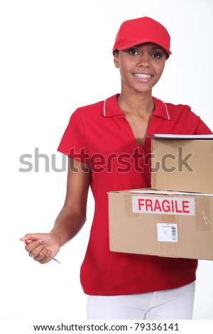 Courier with parcels and clipboard - stock photo