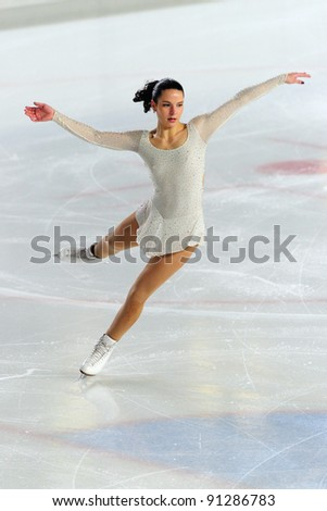 COURMAYEUR, ITALY - DEC 17: Professional skater Roberta Rodeghiero performs free skating at the 2011-12 Italian national figure ice skating Championship on December 17, 2011 in Courmayeur, Italy. - stock photo