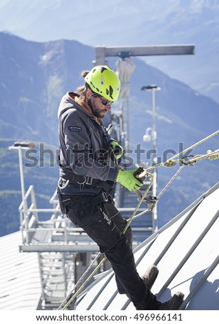 COURMAYEUR, ITALY - JULY 29, 2016:Young eager climber practicing before going up to Mount Blanc