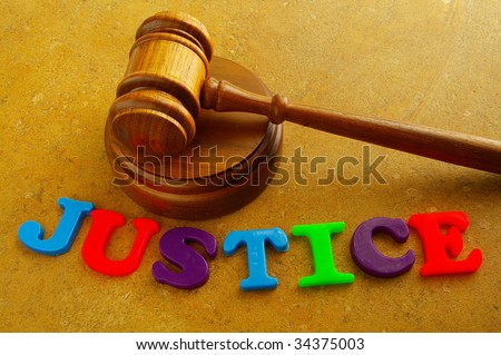 "court gavel with play letters spelling ""justice"" - stock photo"