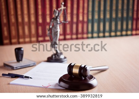 Court Judge's gavel, Themis - the goddess of justice and law codes in the background. Law office. Law concept.  - stock photo