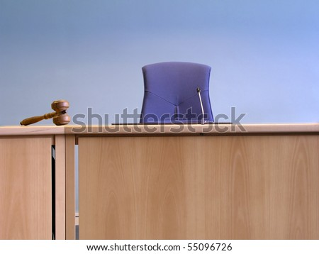 Court's room with tables,chair and hammer - stock photo