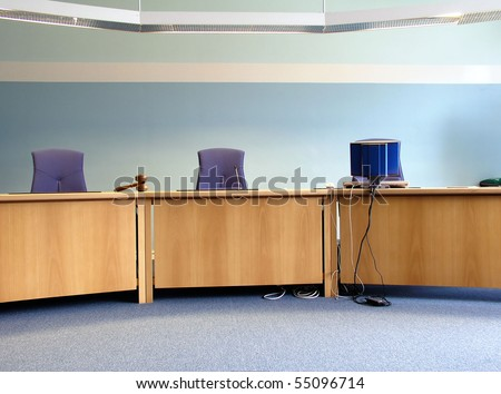 Court's room with tables,chairs,computer and hammer - stock photo