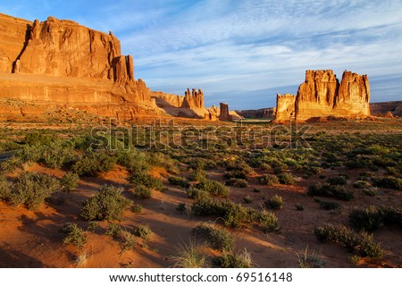 Courthouse Towers panorama in Arches National Park, Utah. From right to left: The Organ, Tower of Babel, Sheep Rock (in shadow), the Three Gossips. - stock photo
