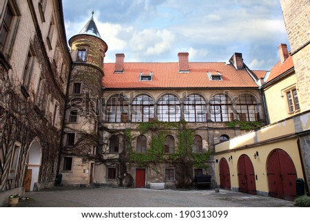 Courtyard and corner tower in Castle Hruba Skala, Czech Republic. - stock photo