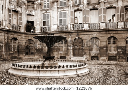 Courtyard and fountain in Aix-en-provence, France.  Sepia tone.