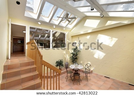 Courtyard area outside kitchen with skylights - stock photo