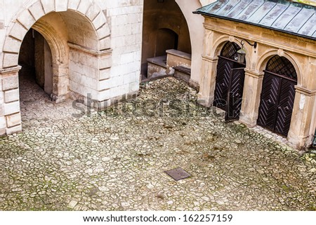 Courtyard castle arcades Pieskowa Skala , medieval building near Krakow, Poland  - stock photo