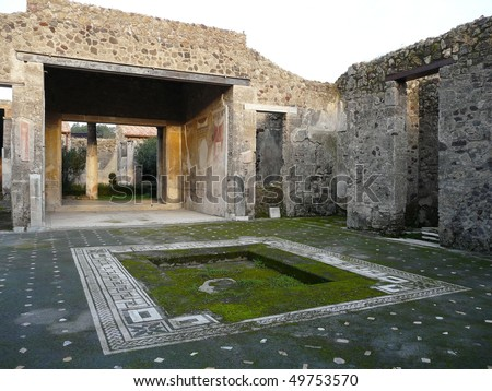 Courtyard of a ruined villa at the ancient Roman city of Pompeii, which was destroyed and buried by ash during the eruption of Mount Vesuvius in 79 AD - stock photo