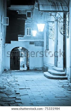 Courtyard of historical buildings in Lviv at night - stock photo