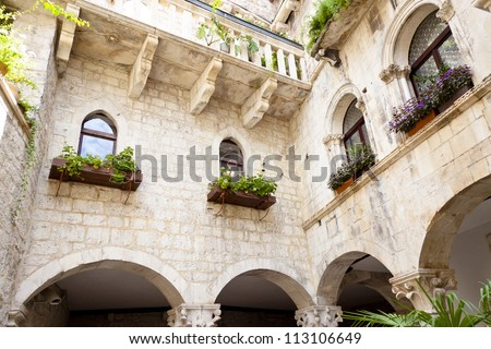 Courtyard of old tenement house - Trogir, Croatia. - stock photo