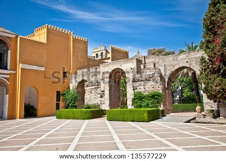 Courtyard of Rolal Alcazar in Seville, Andalusia, Spain - stock photo