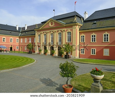 Courtyard of the castle Dobris in Central Bohemia - the rococo chateau with a distinguished facade, Czech Republic, Europe - stock photo