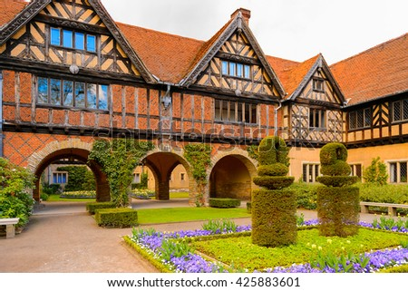 Courtyard of the Cecilienhof Palace, a palace in Potsdam, Brandenburg, Germany. - stock photo