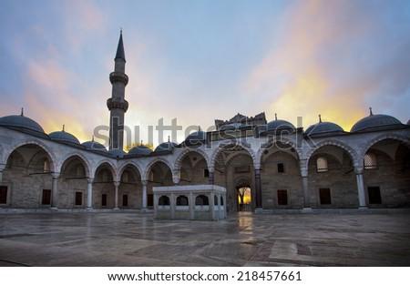 Courtyard Suleymaniye Mosque at sunet in Istanbul, Turkey. - stock photo