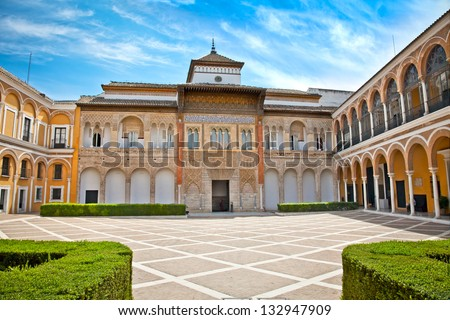 Courtyard with fontain of Alcazar in Seville, Andalusia, Spain - stock photo