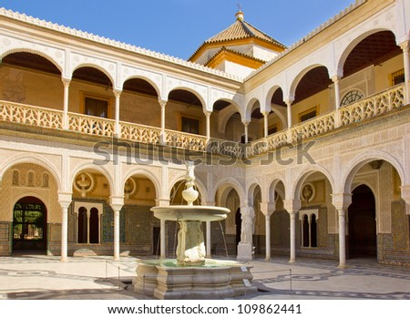 Courtyard with fountain of Casa de Pilatos, Seville, Andalusia, Spain - stock photo