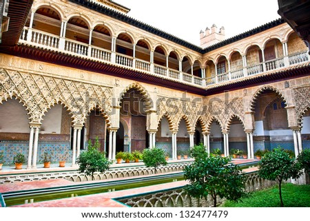 Courtyard with water pool of Casa de Pilatos, Seville, Andalusia, Spain - stock photo
