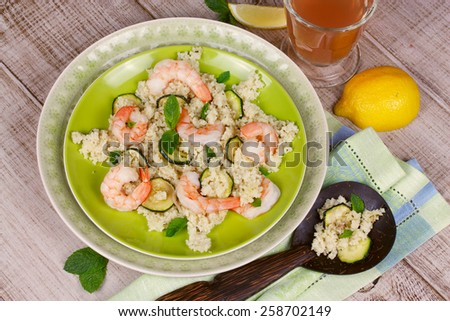 Cous cous salad with shrimps, zucchini and mint - stock photo