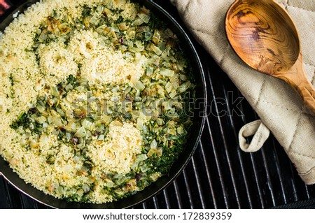 Couscous is a traditional Berber dish of semolina which is cooked by steaming. It is traditionally served with a meat or vegetable stew spooned over it
