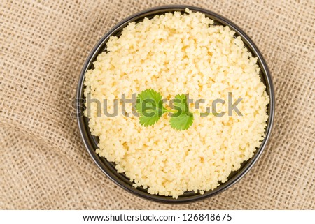 Couscous - Moroccan lemon couscous garnished with coriander leaves. Overhead shot. - stock photo