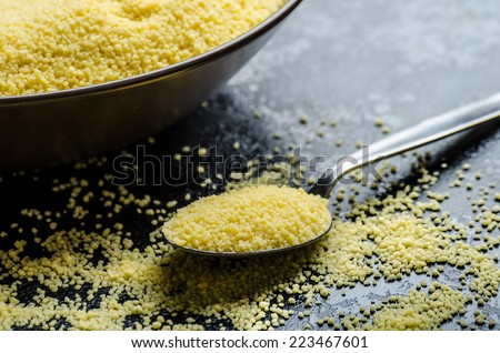 Couscous raw on table and bowl