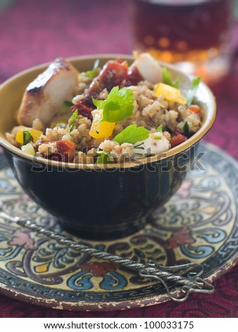 Couscous salad with dried tomato, pepper and parsley, selective focus