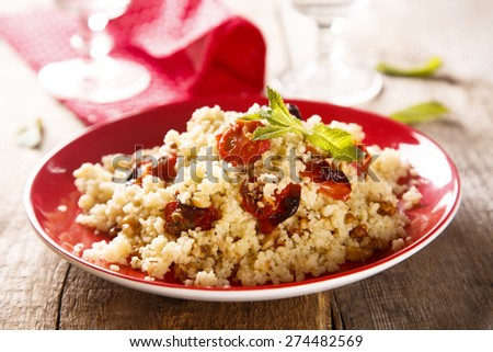 Couscous salad with tomatoes and herbs - stock photo