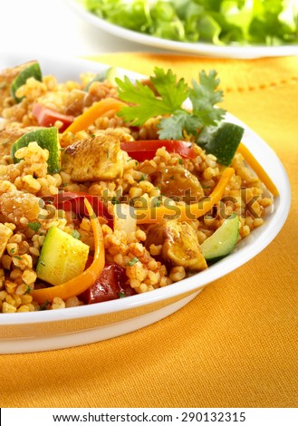 Couscous, tagine with vegetables and chicken in a white plate - stock photo