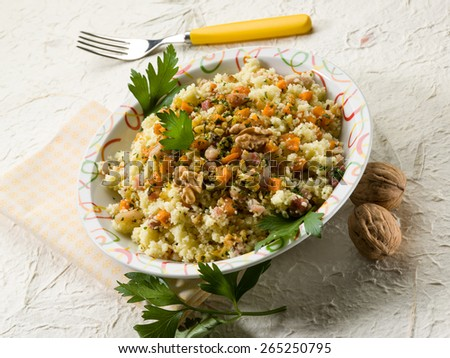 couscous with bacon carrot dried grape and nuts - stock photo