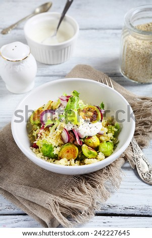 Couscous with brussels sprouts and onions, food - stock photo