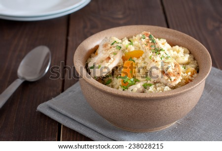 Couscous with chicken and dried apricots   - stock photo