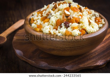 Couscous with dried fruits and nuts - stock photo
