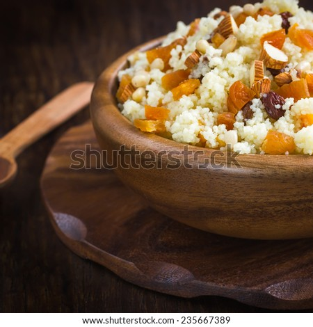 Couscous with dried fruits and nuts, square image - stock photo