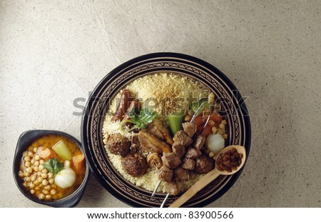 Couscous with meatballs,merguez and brochettes - stock photo
