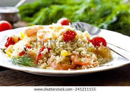 couscous with shrimp, tomatoes and bell peppers - stock photo