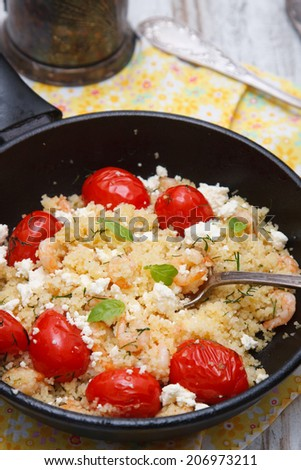 Couscous with tomato,goat cheese and shrimps
