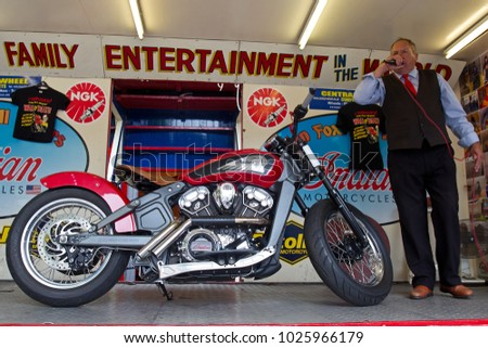 COVENTRY, UK - JUNE 4: A modern Indian Scout motorcycle stands on display in Coventrys shopping area as part of the Wall of Death show for the MotoFest weekend event on June 4, 2017 in Coventry