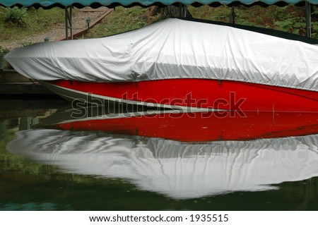 Covered boat in Muskoka, Ontario cottage country - stock photo