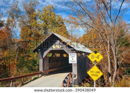 Covered bridge in Vermont in Autumn - stock photo