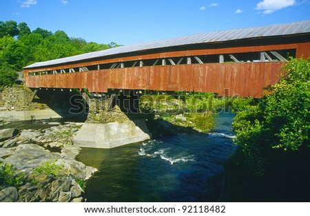 Covered bridge painted red in Taftsville, Vermont, USA - stock photo