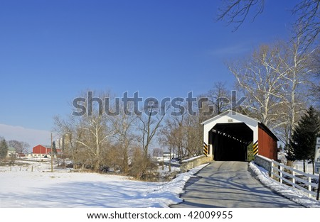 Covered Bridge with Amish Farm - stock photo