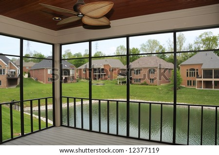 Covered Deck - River view of the community from the screened-in deck.