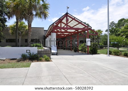 Covered entrance for a modern school building in South Carolina. - stock photo