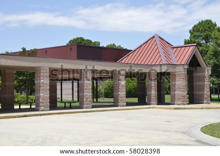 Covered entrance to a modern school building in Hilton Head, South Carolina. - stock photo